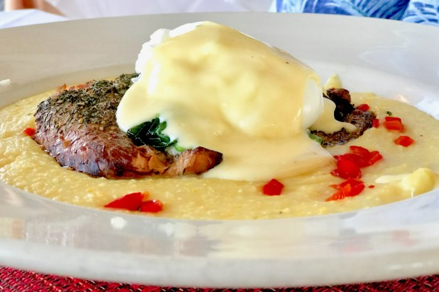 Scottish Smoked Salmon over stone ground grits with sautéed spinach, a poached egg and hollandaise